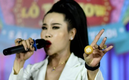 Transgender performer La Kim Quyen of the 'Sai Gon Tan Thoi' LGBT troupe during a lotto show in Binh Duong province, north of Ho Chi Minh City. Photo: AFP