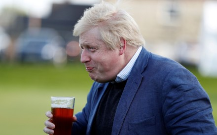 Boris Johnson drinks a beer in 2016. He proclaimed that he was now 'as fit as a butcher's dog' after a recent bout of Covid-19. File photo: Reuters