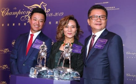 Exultant's owners Eddie Wong Ming-chak (right) and Wong Leung Sau-hing (centre) with son Kirk Wong King-wai (left) at the 2018-19 Champions Awards. Photos: Kenneth Chan