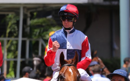 Zac Purton pumps his fist after securing his fourth jockeys' title aboard Fast Most Furious. Photos: Kenneth Chan