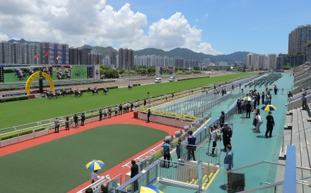 Horses compete at Sha Tin on Sunday in front of largely empty grandstands. Photos: Kenneth Chan