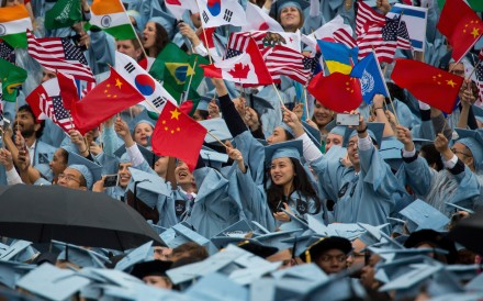 National flags, including Chinese, are waved by graduates of the School of International and Public Affairs during their commencement ceremony at Columbia University in New York in May 2018. Photo: Xinhua