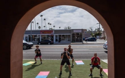Men participate in a CrossFit class outside a gym in Los Angeles, California. Photo: AFP