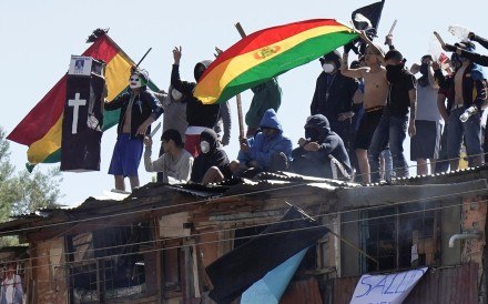 Inmates protest on the rooftop of the San Sebastian prison in Cochabamba, Bolivia on Monday. Photo: Reuters