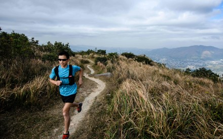 Stone Tsang Siu-keung knows a mask will make running uncomfortable but hopes people will comply. Photo: Agence France-Presse