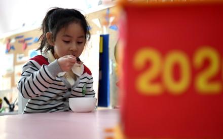A girl eats porridge at a kindergarten in Shijiazhuang, north China's Hebei Province, Jan. 2, 2020. Photo: Xinhua