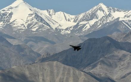 An Indian Air Force aircraft flies near Leh, in Ladakh, on June 27. Photo: AFP