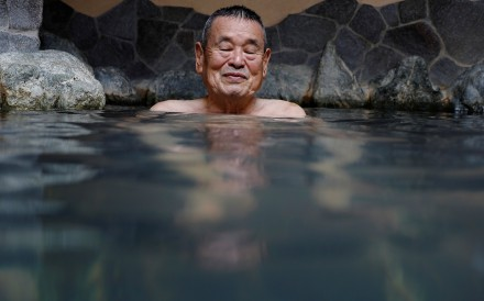 A customer soaks himself in a bath at Takuya Shimbo's public bathhouse Daikoku-yu in Tokyo. Photo: Reuters