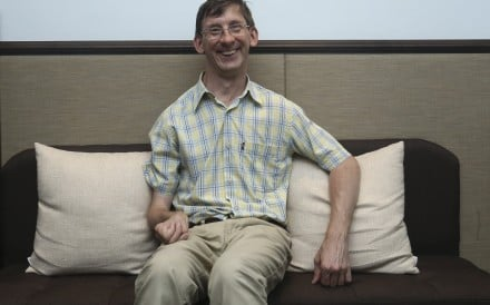 Edward Bunker, a reiki practitioner at Balance Health in Hong Kong's Central district, has been partially paralysed on his right side since birth. Photo: Jonathan Wong