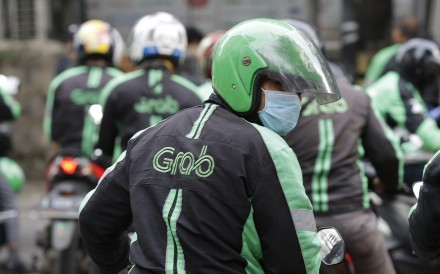 Singapore-based ride-hailing app operator Grab is currently valued at US$14.3 billion, according to CB Insights. Photo: AP