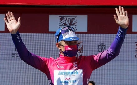 Belgian cyclist Remco Evenepoel celebrates on the podium of the Vuelta a Burgos, Spain. Will masks be the norm at the Tour de France. Photo: EPA