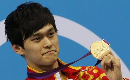 China's Sun Yang with his 1,500m freestyle gold at the London 2012 Olympic Games. Photo: EPA