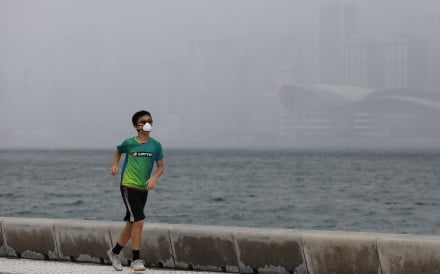 Hongkongers have to wear masks at all times, even when exercising, making for a very uncomfortable experience in the heat and humidity. Photo: May Tse