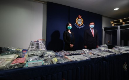 Chief Inspector Ip Siu-lan (left) and Senior Superintendent Ng Kwok-cheung (right) of the Narcotics Bureau stand behind a haul of recently seized drugs at a press conference on Friday. Photo: Xiaomei Chen