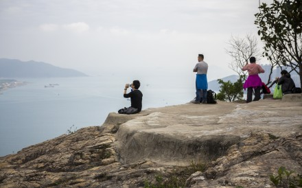 Hikers overlook Tseung Kwan O from Devil's Peak, near where police issue fines for lack of masks. Photo: Christopher DeWolf