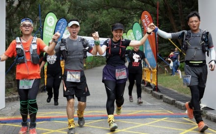 A team crosses the finish line at the 100km Oxfam Trailwalker. They will have to wait until January 2021 for the next edition. Photo: Tory Ho