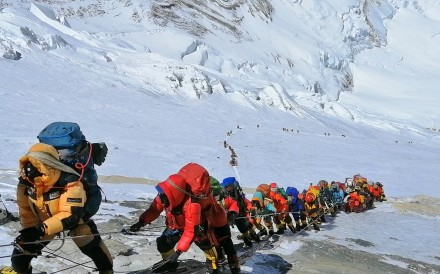 A long queue of mountain climbers on Mount Everest, just below camp four, in 2019. Photo: AP