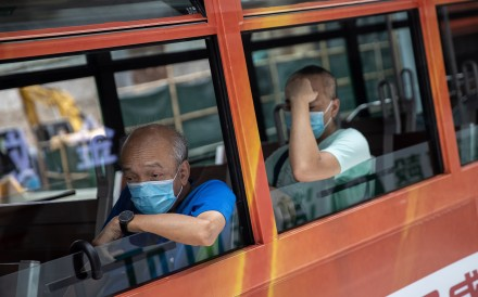 Passengers wear face masks on a tram in Hong Kong. Photo: EPA-EFE