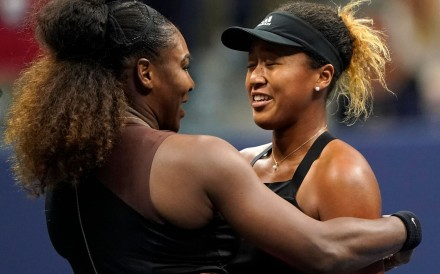 A transfer of power? Naomi Osaka and Serena Williams of the US meet at the net after their 2018 US Open women's singles final match. Photo: AFP