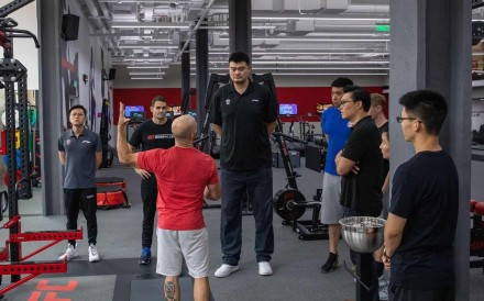 NBA legend and Chairperson of Chinese Basketball Committee Yao Ming with UFC Shanghai Performance Institute coaches and Kevin Chang, UFC vice-president of Asia Pacific. Photo: Handout