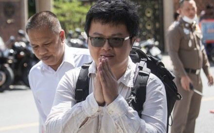 Pro-democracy activist and human rights lawyer Arnon Nampha arrives at a police station in Bangkok on August 25. Photo: AP