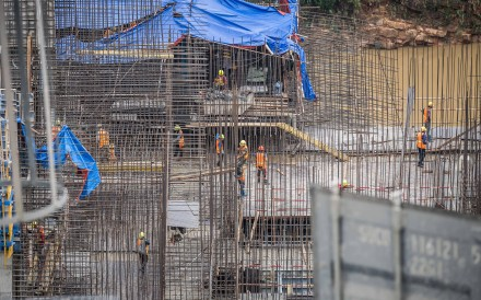 Chinese construction workers are seen at a building site in Laos. US sanctions on 24 Chinese firms may affect ongoing projects, but could also open up opportunities for Chinese companies not on the blacklist. Photo: Xinhua