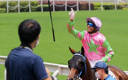 Jockey Joao Moreira throws his whip after a win at Sha Tin. Photos: Kenneth Chan