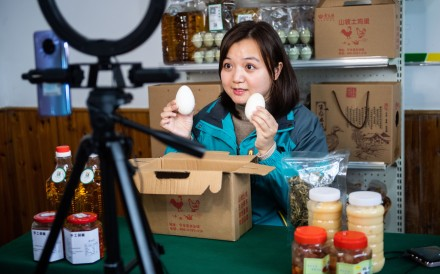 Zhang Qin, an overseas returnee, introduces eggs on March 13 via a live stream on an e-commerce platform she founded in Huitang village in central China's Hunan Province. Photo: Xinhua