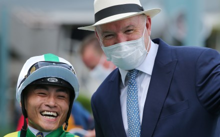 Jockey Keith Yeung and trainer David Hayes celebrate Moneymore's win at Sha Tin on Sunday. Photos: Kenneth Chan