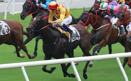 Gold Chest (middle) bursts through a gap to win at Sha Tin on Sunday. Photos: Kenneth Chan