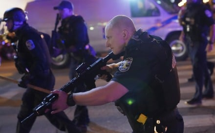 Police in Louisville, Kentucky respond in the aftermath of the grand jury's decision. Photo: AP