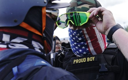 A member of the Proud Boys (right) stands in front of a counter protester during a right-wing rally in Portland on Saturday. Photo: AP