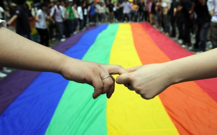 LGBT activists in Hong Kong form a human chain around a rainbow flag during celebrations marking the fourth annual International Day Against Homophobia, in May 2008. The event was launched in 2005 to commemorate the day in 1990 when the World Health Organization removed homosexuality from its list of mental disorders. Photo: AFP