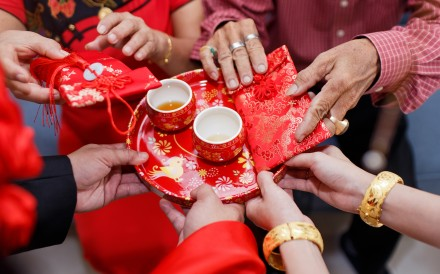 A bride and groom take part in a traditional tea ceremony, a key event during Chinese weddings. The notion that a child is best raised in a family with a mother and a father is still strong in Hong Kong culture. Photo: Shutterstock