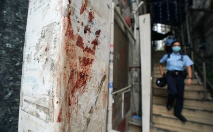 Blood stains can be seen at the site of a brawl that erupted in Tsim Sha Tsui. Photo: Felix Wong