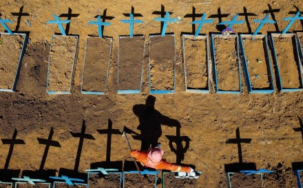 A gravedigger stands at the Nossa Senhora Aparecida cemetery where Covid-19 victims are buried daily, in Manaus, Brazil in June. Photo: AFP