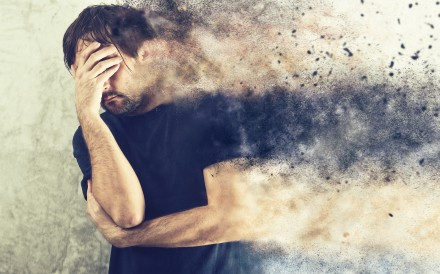 Depressed Man with Problems holding hand over his Face and Crying, occupied by Mind Blowing Thoughts CREDIT: Shutterstock