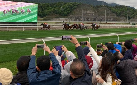 Racing fans at Conghua racecourse. Photo: Noel Prentice