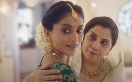 A still from Tanishq's pulled 'Ekatvam' advert shows the pregnant Hindu wife character being escorted to her baby shower by an older Muslim woman she calls mother. Photo: YouTube