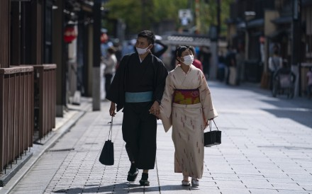 A Japanese couple strolls through Kyoto. Husbands and wives surveyed in the country said the most common issue they kept secret from each other had to do with money. Photo: EPA
