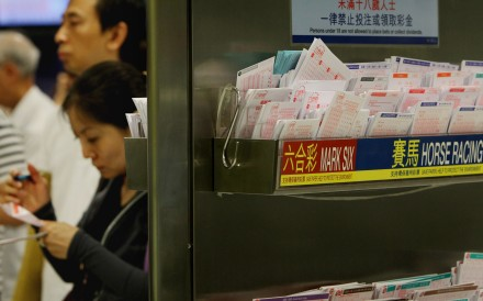 People queue to bet at a Jockey Club branch. Photo: SCMP