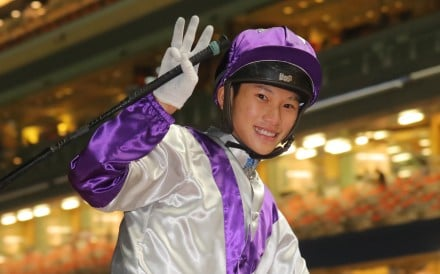 Jerry Chau flashes a smile after completing a treble at Happy Valley on Wednesday night. Photo: Kenneth Chan