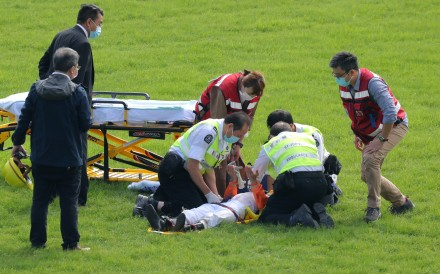 Matthew Chadwick in the hands of paramedics after a fall at Sha Tin on Sunday. Photos: Kenneth Chan