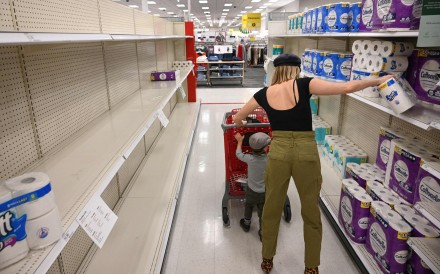 A shopper picks up a package of toilet paper at a store in Burbank, California, on November 19. Paper towels and other cleaning supplies are flying off retail shelves amid a new wave of panic buying as the United States faces the most recent surge in coronavirus infections. Photo: AFP