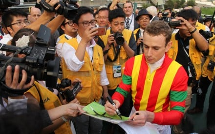Ryan Moore surrounded by press after winning the 2016 Hong Kong Cup aboard Maurice. Photos: Kenneth Chan