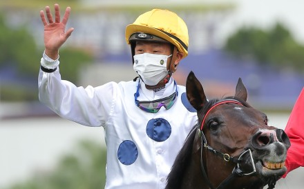 Vincent Ho celebrates his Hong Kong Mile win aboard Golden Sixty. Photos: Kenneth Chan