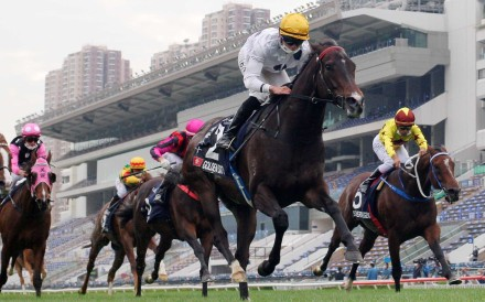 Vincent Ho guides Golden Sixty to victory in the Group One Hong Kong Mile. Photo: Kenneth Chan
