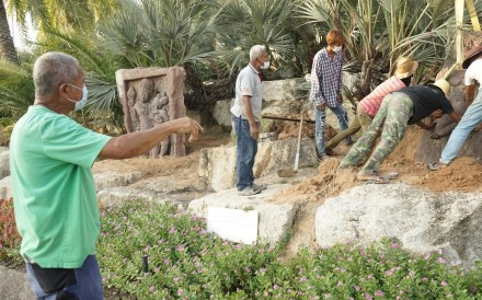 Kampon Tansacha, the owner of Noongnooch Tropical Garden, directs his landscaping crew in making refinements to the park. Photo: Vijitra Duangdee