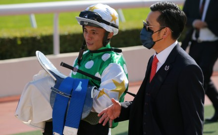 Apprentice Alfred Chan and trainer Frankie Lor discuss Golfman Star's win at Sha Tin in December. Photos: Kenneth Chan