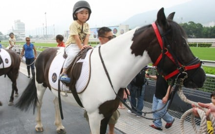 Children enjoy the pony rides during a preseason carnival at Sha Tin racecourse. Photo: Kenneth Chan